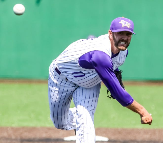 Kansas Wesleyan's Kaden Sitzman (17) delivers a pitch during game two of a doubleheader against Southwestern Saturday at Dean Evans Stadium.