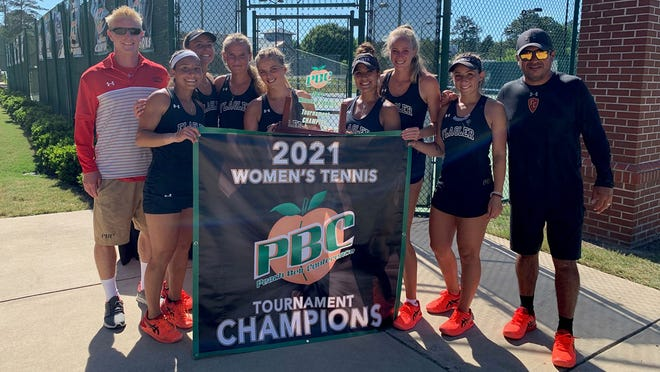 No. 14 Flagler College women's tennis team celebrates after upsetting top-seeded Columbus State in the Peach Belt Conference championship match Saturday in Columbus, Georgia. The Saints will advance to the NCAA Division II Regionals at North Georgia.