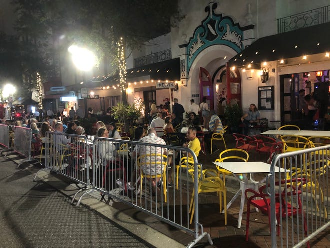 El Melvin and its neighboring restaurants on downtown Sarasota's Main Street use the parallel parking spaces to provide expanded outdoor seating.
