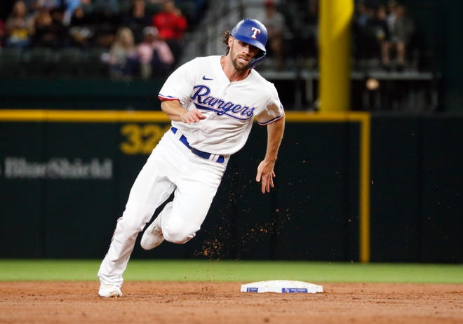 Rangers shortstop Charlie Culberson heads to third base on a single by third baseman Isiah Kiner-Falefa during the third inning against the Red Sox.