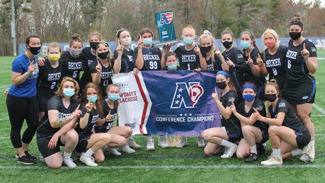 The Becker women's lacrosse team celebrates its NECC championship on Sunday.