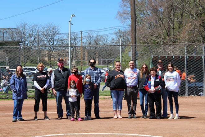 Members of the Wellsville Softball Diamond of Honor Class of 2021 and their families gather for a photo at Tullar Field Saturday.