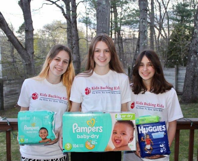 The Kids Backing Kids diaper drive is underway in Wellesley. Pictured are Wellesley High School junior Olivia Rodrigue, senior Grace Rodrigue and Wellesley Middle School student Simone Rodrigue.