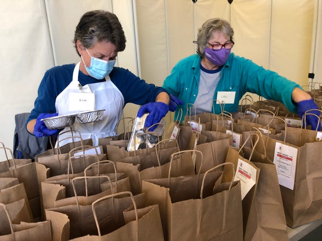 At Soup Kitchen In Provincetown, Kim Anstey (left) and Libby Cressey help prepare meals. The nonprofit community meal program ended for the season on April 30.