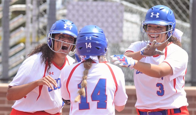 ooper's Jennika Willis, left, and Kaleigha Kemp, right, greet Summer Simmons at the plate after Simmons' two-run home run put the Lady Coogs up 4-0 in the first inning against Amarillo Caprock.