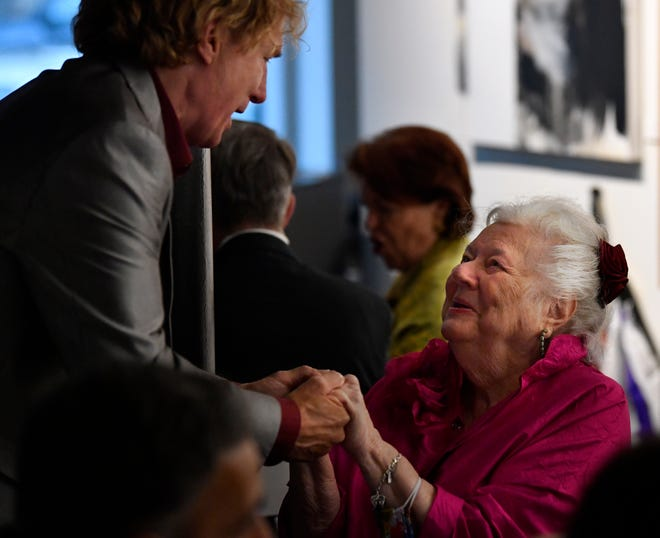 "Betty ""Poppy"" Crowe is greeted by Nelson Coates during Saturday's dinner at CCA."
