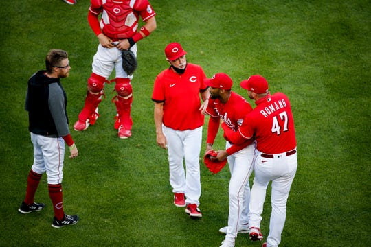 Cincinnati Red starting pitcher Sal Romano (47) holds back Cincinnati Red's emergency pitcher Amir Garrett (50) as the benches clear in the eighth inning of the baseball game against the Chicago Cubs, Saturday, May 1, 2021 at Great American Ball Park in Cincinnati.