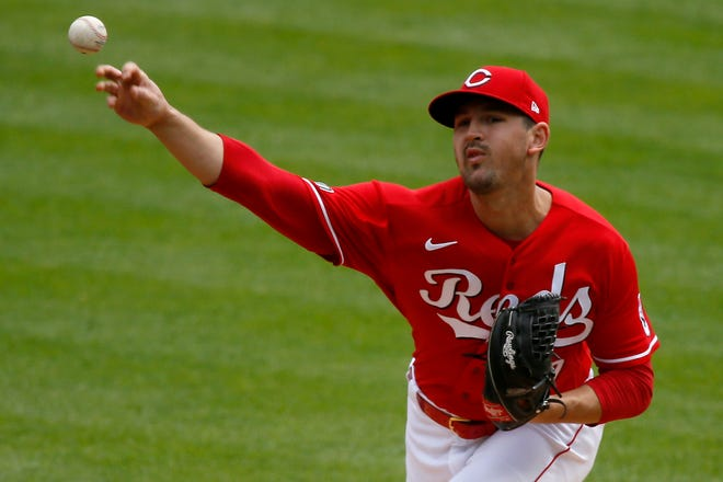 Tyler Mahle was scheduled to take the mound for the Reds in Cleveland on Sunday.
