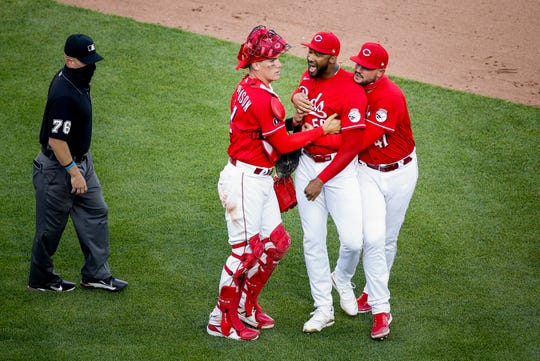 Cincinnati Reds catcher Tyler Stephenson (37) and Cincinnati Reds starting pitcher Sal Romano (47) hold back Cincinnati Reds relief pitcher Amir Garrett (50) as the benches clear in the eighth inning of the baseball game against the Chicago Cubs, Saturday, May 1, 2021 , at Great American Ball Park in Cincinnati.