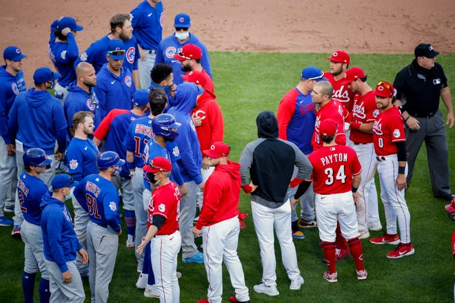 The benches clear after Cincinnati Reds relief pitcher Amir Garrett (50) struck out Chicago Cubs first baseman Anthony Rizzo (44) in the eighth inning of the baseball game against the Chicago Cubs, Saturday, May 1, 2021, at Great American Ball Park in Cincinnati.