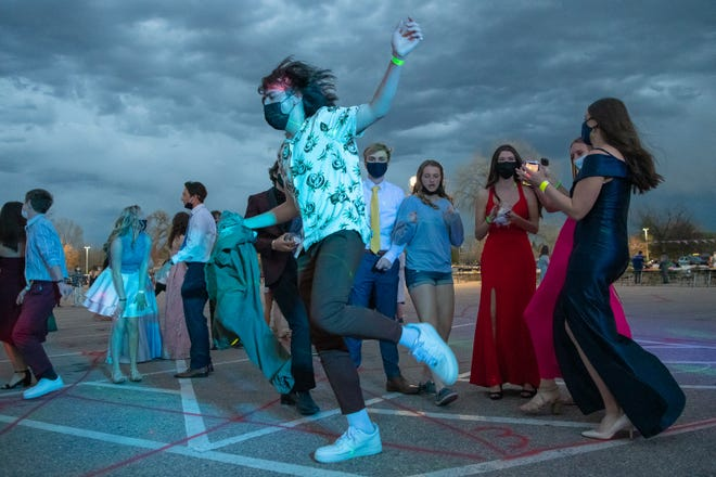 Zul Gorecki, 18, dances in a Rocky Mountain High School parking lot during the school's prom on Saturday, May 1, 2021, in Fort Collins, Colo. The prom was held outside because of COVID-19 safety concerns.