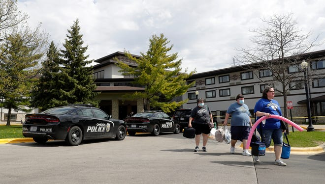 Guests leave the Oneida Casino/Radisson Hotel & Conference Center on Sunday morning after a shooting took place on Saturday at the Duck Creek Restaurant where three people were killed, including the gunman, and one person was seriously injured.