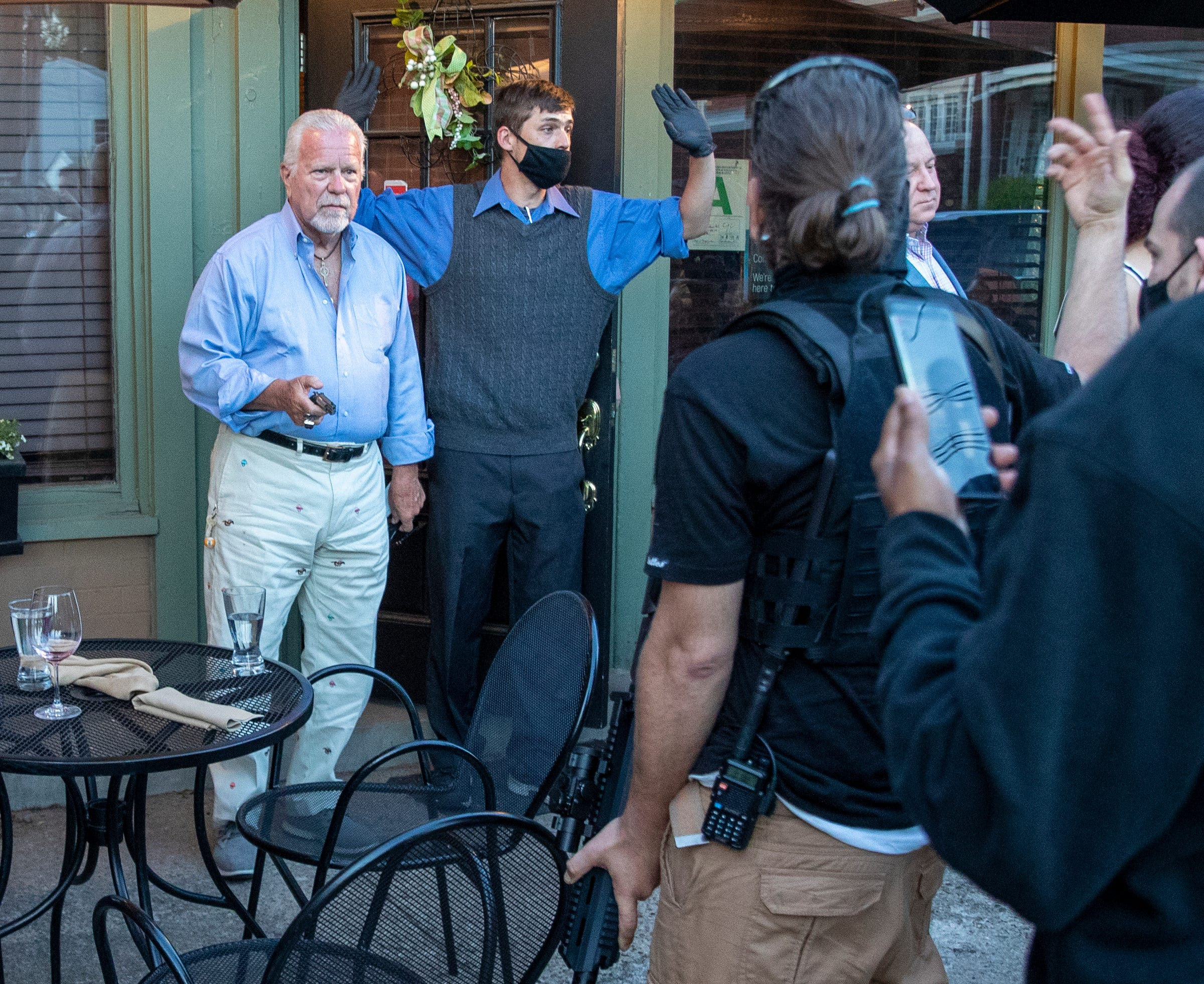 Tense moment between Louisville protesters and gun carrying restaurant patron
