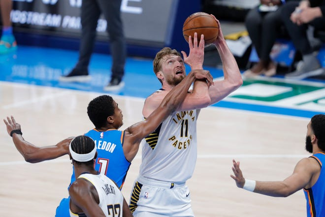 May 1, 2021; Oklahoma City, Oklahoma, USA; Indiana Pacers forward Domantas Sabonis (11) is fouled by Oklahoma City Thunder guard Theo Maledon (11) on the way to the basket during the third quarter at Chesapeake Energy Arena. Mandatory Credit: Alonzo Adams-USA TODAY Sports