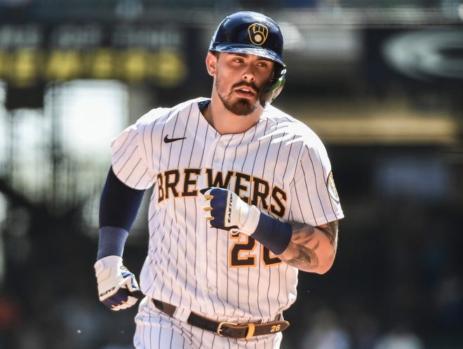 Brewers catcher Jacob Nottingham tours the bases after belting a solo home run against the Dodgers in the third inning.