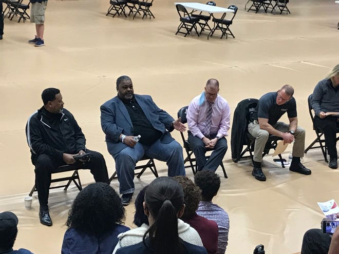 Lorenzo Boyd (second from left), vice president for diversity and inclusion at the University of New Haven, speaks to participants in a Saturday, May 1, 2021, forum on police and community engagement, held at the Muncie Fieldhouse. Also shown are Frank Scott, president of the Whitely Community Council; Jim Duckham, Ball State University police chief, and Nathan Sloan, Muncie police chief.