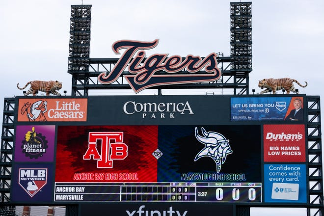 Logos for Anchor Bay and Marysville are displayed on the scoreboard before they face off Saturday, May 1, 2021, at Comerica Park.