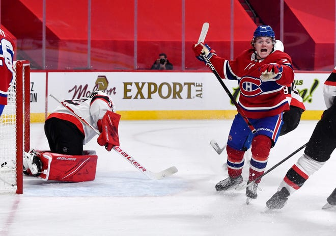 Montreal Canadiens forward Cole Caufield (22) reacts after scoring the winning goal against the Ottawa Senators during the overtime period at the Bell Centre on Saturday in Montreal. It was Caufield's first NHL goal.