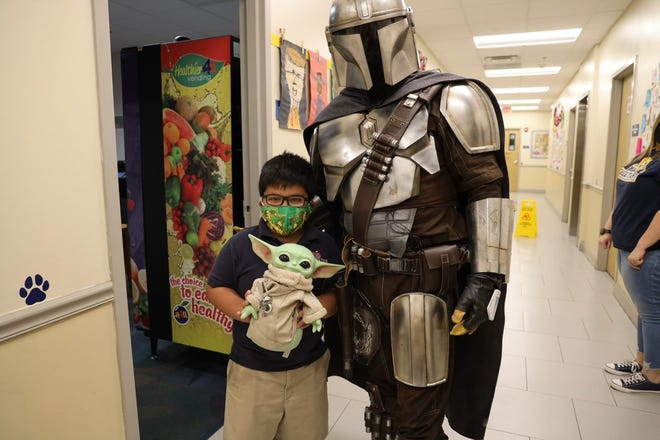 The Mandalorian — a well-known Star Wars character — and his beloved Grogu (otherwise known as Baby Yoda) visited the Tallahassee School of Math and Science on April 23.