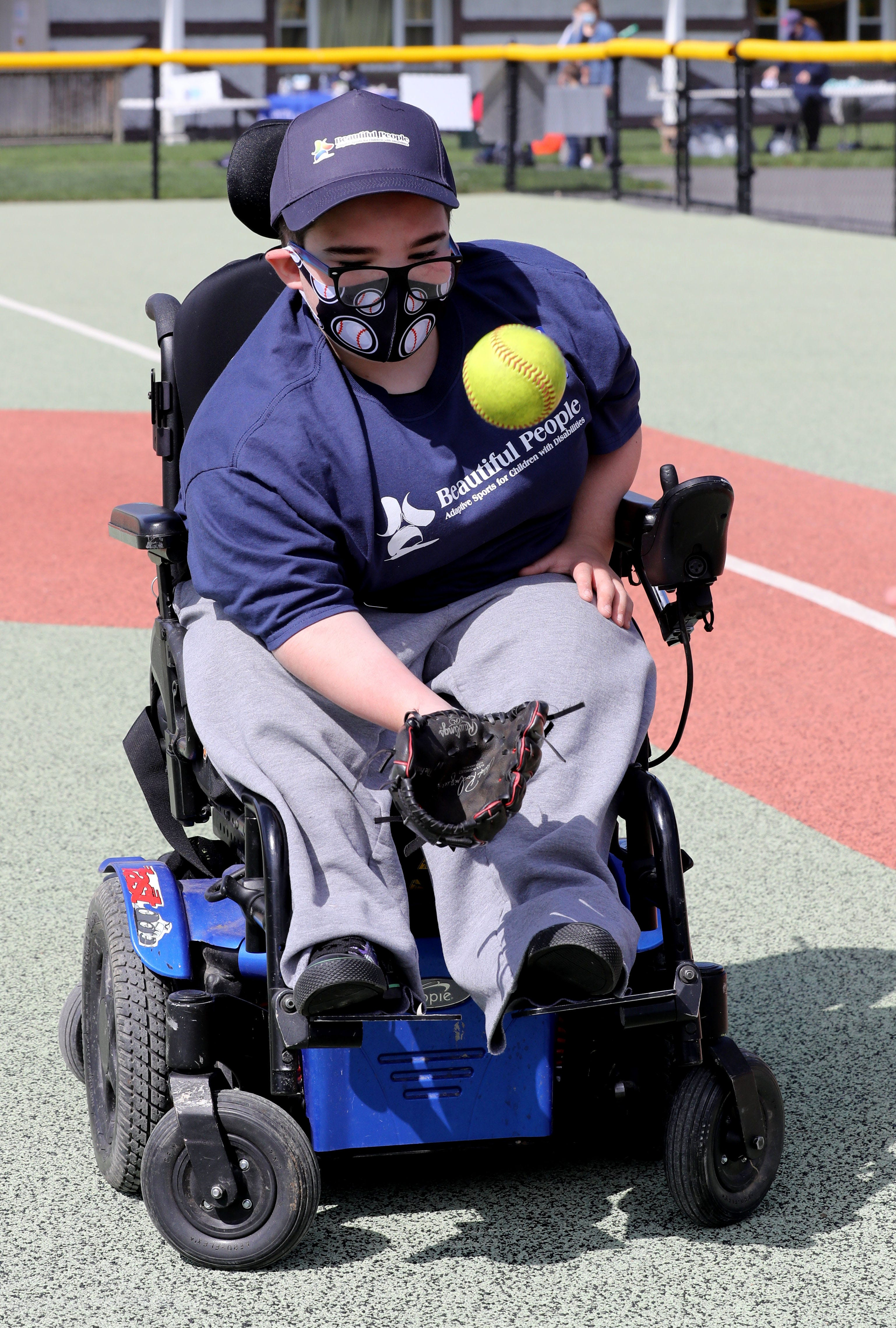 Kenny Grunenberg, 9, catches a ball during opening day for Beautiful People Baseball in Warwick, N.Y. May 2, 2021. The baseball program is one of the sports offered by Beautiful People, which provided adaptive sports for children with disabilities.