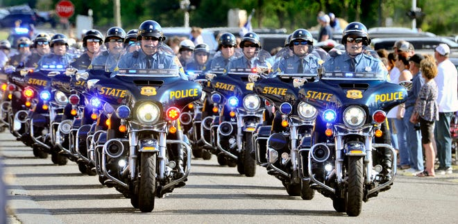 A Delaware State Police motorcycle unit escorts the hearse carrying the body of Delmar Cpl. Keith Heacook through Delmar on Sunday, May 2, 2021.