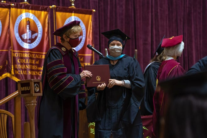 A graduate student poses for a photo with Dr. Suzanne Shipley, president of Midwestern State University, after receiving their diploma during graduation ceremonies as show in this file photo.