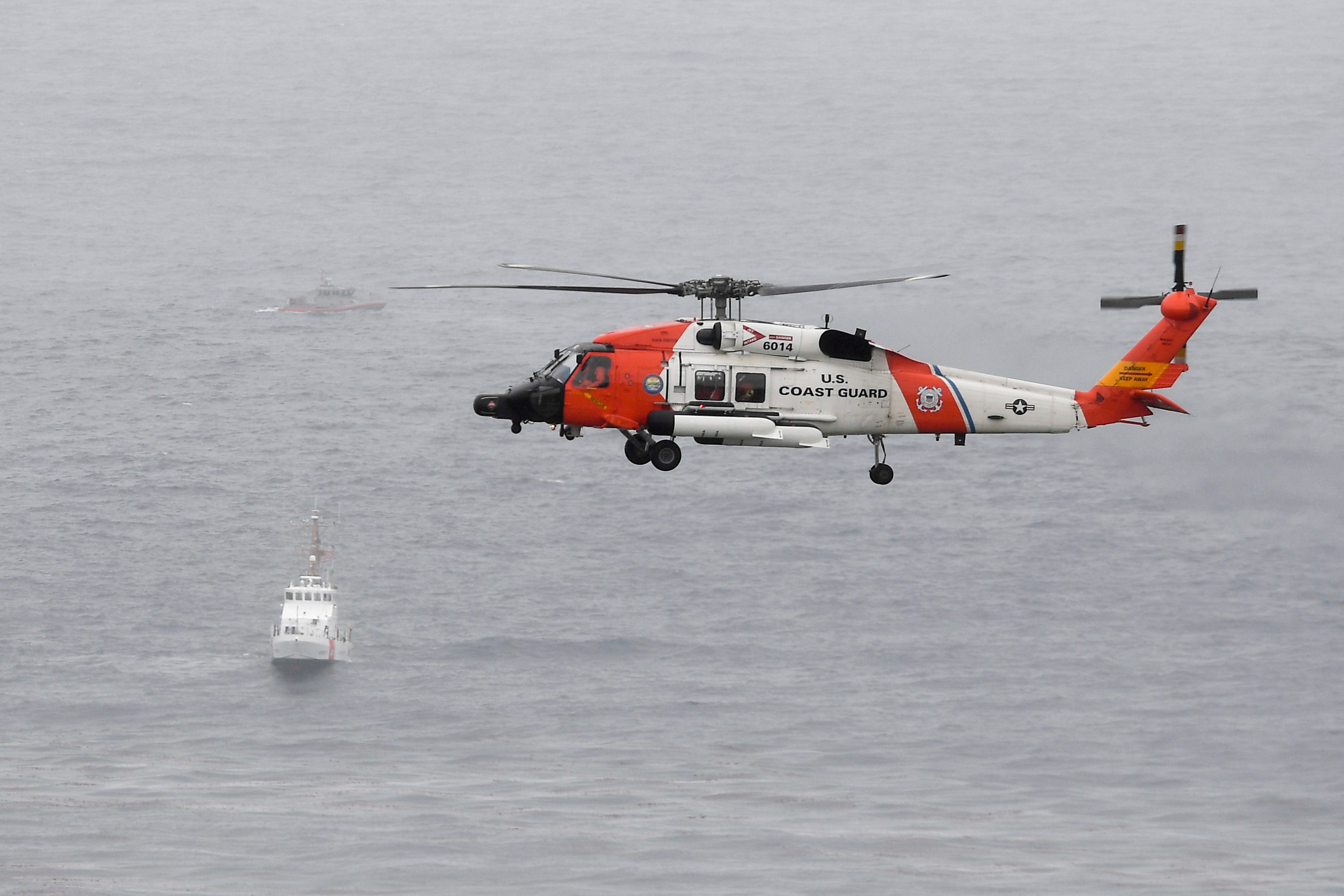 Photos show search crews after capsized boat off the coast of San Diego