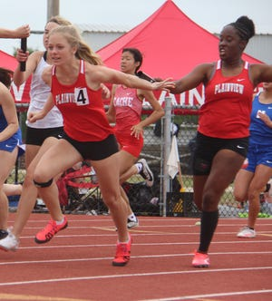 Plainview's Molly Harlow, left, receives the handoff from Eshaya Lewis during the 4x100 relay. Harlow and Lewis joined Emilee Hudson and Kate Brown to take first at 50.91.