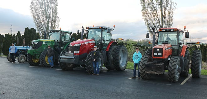 Crestview High School celebrated Farm Week the last week of April. On Friday, FFA students were allowed to drive a farm tractor to school. Among those who did included, from left, Austin Barcroft, Jake Smith, Payton Eichelberger and Colton Eichelberger. Thirteen students drove tractors to the school.