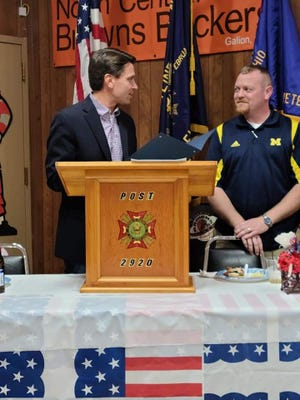 Ashland Mayor Matt Miller, left, presents VFW District 10 Commander Andrew Leidigh with a proclamation Saturday night at the testimonial dinner at the Crestline VFW. Leidigh is a member of Ashland VFW Post 1067.