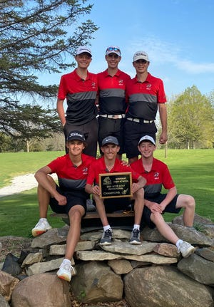 Members of the Gilbert boys' golf team pose with their championship plaque after winning the Winterset Invitational Friday at the Lakeview Country Club in Winterset.