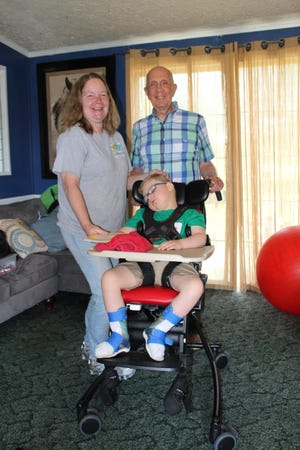 Former Hampton Mayor John Rhoden and his family recently made a donation to help fulfill the needs and wishes of Colten Cain. Rhoden is pictured with Colten and his grandmother, Sherry Crosby.