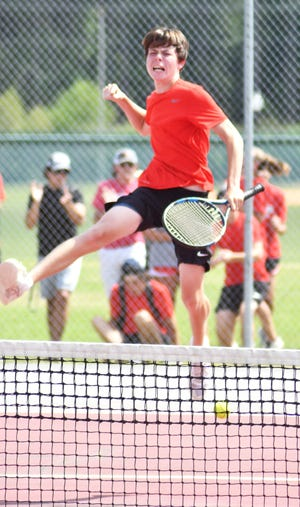 Screven County No. 3 singles player Mason Forehand leaps high and pumps his fist April 29 after winning his semifinal match to send the Gamecocks into the Saturday Class A state tennis championship. Forehand's 7-5, 6-4 victory advanced SCHS to the matches being held at Berry College.