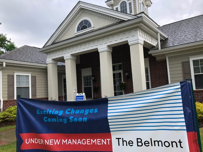 A banner announcing the transition from the Saddle Creek on Washington apartments to The Belmont sits in front of the complex's office in Evans on Monday.