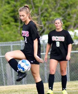 Lady Gamecock senior Lauren Brannen controls the ball for Screven County as the girls take another step in the Class A state playoffs.