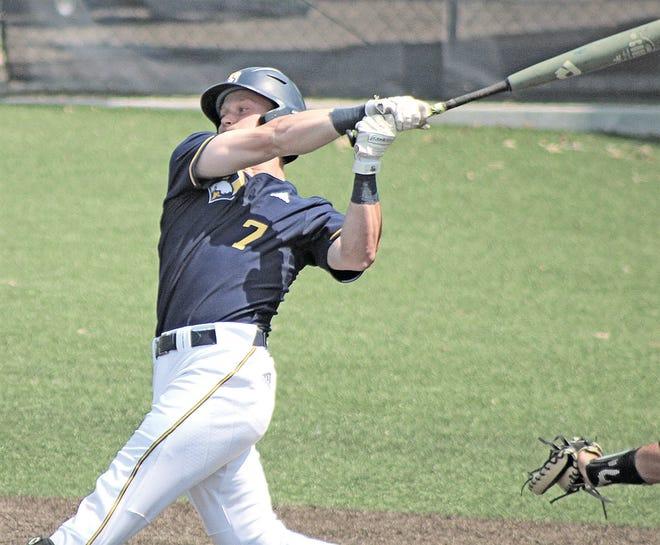 Josh Logan launches a hit for the Oklahoma Wesleyan University baseball team.