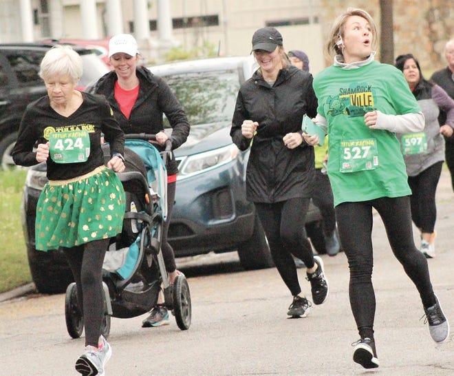 Scharilyn Finney, left, focuses on running a good race during the recent Shamrock the 'Ville.