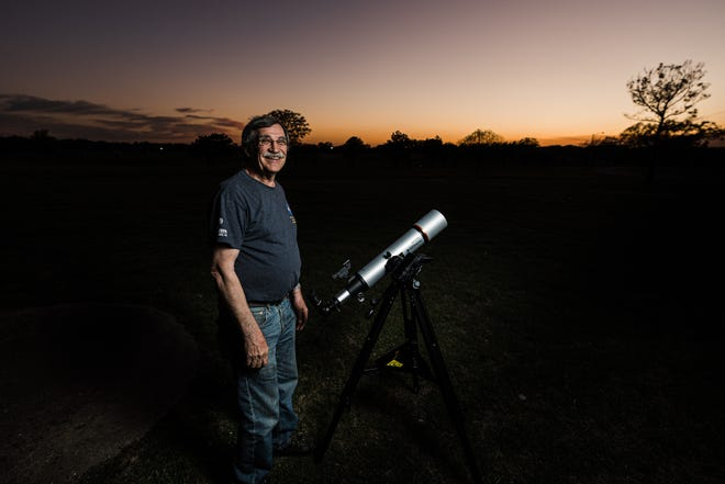 Craig Brockmeier, president of the Bartlesville Astronomical Society, sets up a telescope for some stargazing.