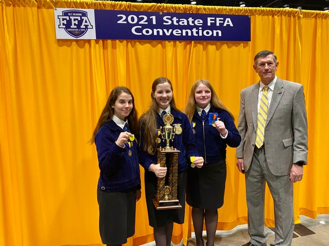 Bartlesville FFA chapter members Adysen Grindle, left, Mia Merciez and Haley King won first-place honors in the agricultural communications career development event during the 2021 Oklahoma FFA Interscholastics at Oklahoma State University on April 24. OSU professor and department head Rob Terry presented the award to the team.