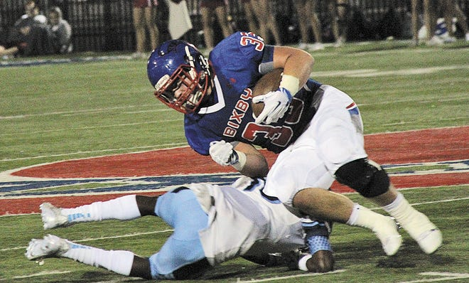 Bartlesville High defensive back A.J. Parker brings down dangerous Bixby running back Nic Roller on a solo open field tackle during Bartlesville's state semifinal season of 2015.