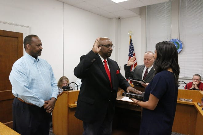 Harold Hogan is sworn into office as justice of the peace in Precinct 2 during Monday's meeting of the Brown County Commissioners Court. Brown County Judge Paul Lilly administers the oath as Hogan's daughter, Mashari Hogan, holds a Bible for her father. Brownwood Mayor Pro Tem Draco Miller stands next to Hogan.