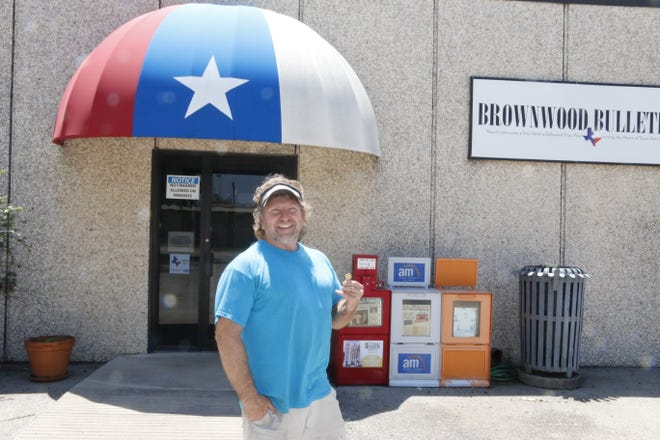 Mike Degal is pictured Monday outside the front entrance of the building at 700 Carnegie that was the home of the Brownwood Bulletin for 50 years.