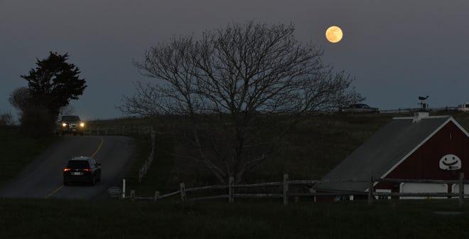 The pink super moon rises on April 26.