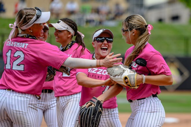 Missouri's Casidy Chaumont (12) and Brooke Wilmes (7) congratulate pitcher Laurin Krings (23) after a key strikeout during a game against Florida on May 2 at Mizzou Softball Stadium.