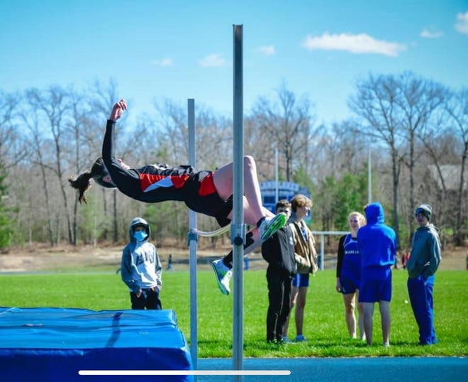 Onaway sophomore Madilyn Crull jumps over the bar during the high jump event at the Inland Lakes quad meet held on Friday, April 30. On that day, Crull tied the 44-year high jump school record of 5-0 held by former Cardinal Diane Tucker.