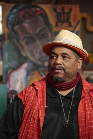 Richard Duarte Brown, a mixed-media artist, poses for a portrait on Monday, May 3, 2021 at Transit Art Studio in Columbus, Ohio.