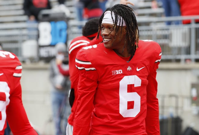 Jameson Williams, walking off the field after the Ohio State spring game on April 17, caught nine passes for 154 yards and two touchdowns last season.