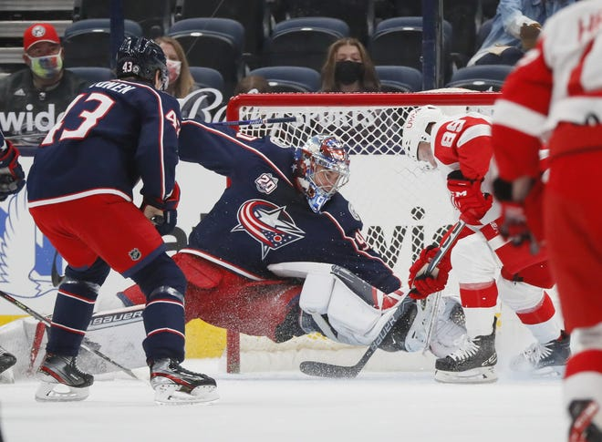 Blue Jackets goaltender Elvis Merzlikins, making a diving save against Detroit last Tuesday, had stopped 79ofthe past 82shotshe faced heading into Monday's game.
