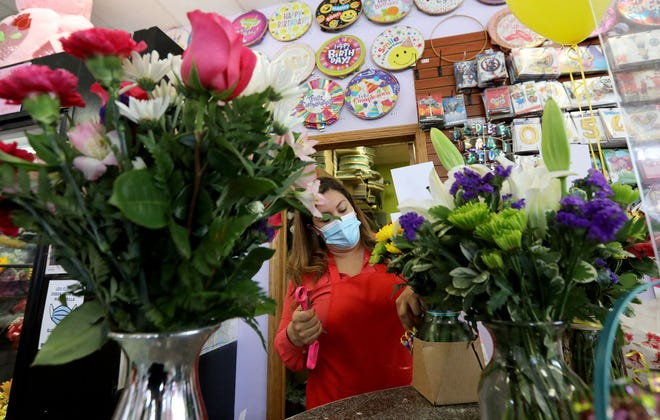 Jackie Gonzalez prepares flower orders for customers on April 30, 2021, at Crystal Flower shop in Chicago's Little Village neighborhood. Crystal Flower is among the florists who say they're having to substitute flowers and raise prices as they face a shortage of flowers, plants, vases and other supplies. (Antonio Perez/Chicago Tribune/TNS)