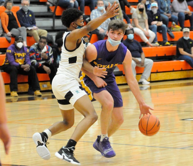 Blissfield senior Ty Wyman, right, moves with the ball as Romulus Summit Academy's Orlando Lovejoy during their Division 2 regional semifinal game at Tecumseh on Tuesday, March 30.